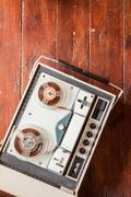 Old tape recorder on wooden background Stock Photos