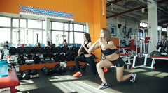 Two women stretching before gym workout 20s. 1080p Slow Motion Stock Footage