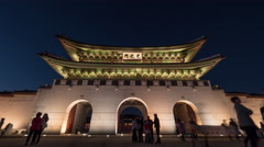 Timelapse of citizens and tourists by Gwanghwamun Gate at night. Seoul, South Stock Footage