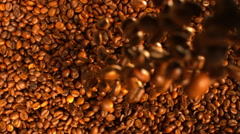 Flow of Coffee Beans Falling Down in the Pile in slow motion tabletop Stock Footage