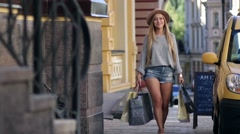 Elegant woman carrying shopping bags and smiling Stock Footage