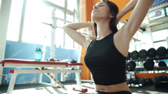Cute Sporty young woman doing exercise in a fitness center with her personal Stock Footage
