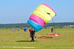 Skydiver landed after the jump Kuvituskuvat