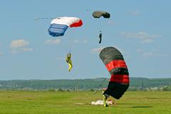 Skydiver landed after the jump Stock Photos