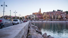 Menton old town with waterfront from evening to night timelapse Stock Footage