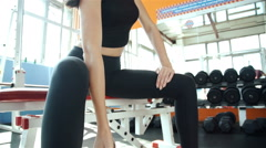 The sports girl does exercises, workout with dumbbells on a gym background 20s Stock Footage