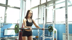 Attractive young woman is engaged in fitness sport club 20s. 1080p Slow Motion Stock Footage
