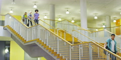 Cheerful student running through college building Stock Footage