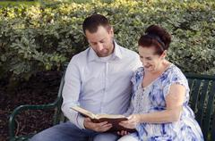 Reading the Bible together. Stock Photos