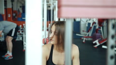 Close up strong female back during work out at gym slow motion 20s. 1080p Slow Stock Footage