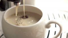 Coffee flows in a cup, slow motion Stock Footage