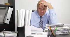 Manager at Office in Accounting Department Working to Solve All Paper Documents Stock Footage