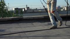 Roofer melts the bitumen Stock Footage