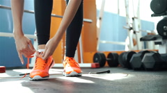 Girl tying shoelaces sneakers and takes a skipping rope 20s. 1080p Slow Motion Stock Footage