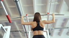 Dip ring girl woman 20s muscle ups rings workout at gym 20s. 1080p Slow Motion Stock Footage