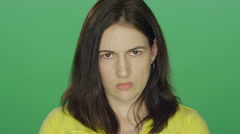 Brunette woman looking really upset, on a green screen background Stock Footage