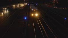Beltway traffic train night Stock Footage
