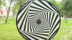 Hypnotic spiral tunnel circle looping in the park in sunny summer day. Stock Footage