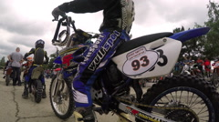 Racing motorcycles in motocross competition Stock Footage