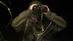 A soldier with boniculars Stock Footage