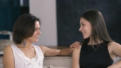 Happy young mother gently communicates with a teen daughter Stock Footage