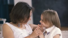 Happy young mother gently communicates with a small cute daughter. Slow motion Stock Footage