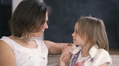 Happy young mother gently communicates with a small cute daughter Stock Footage