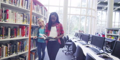Diverse student group studying together in modern college library Stock Footage