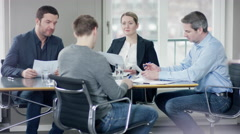 Young men have a jobinterview in a meetingroom Stock Footage