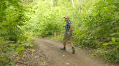 Man afraid and run away from persecution in the open air in the forest. Stock Footage