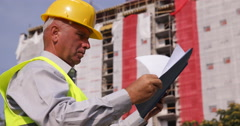 Engineer Checking Folder Files Documents in a Construction Building Site Area Stock Footage
