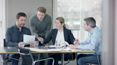Business people have a discussion about documents at a businessmeeting in off Stock Footage