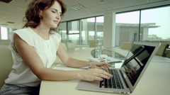 Businesswoman using laptop Stock Footage