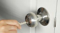 Hand Torque keys aluminum door knob door to open. Stock Footage