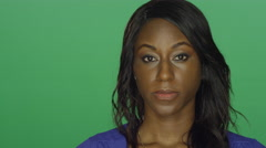 African American woman looking disappointed, on a green screen background Stock Footage
