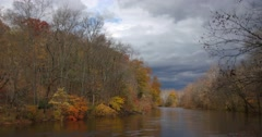 Autumn River with Dark Clouds and Shadows, static shot Stock Footage