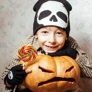 Little cute boy with halloween pumpkin close up holding candy, trick or treat Stock Photos