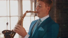 Saxophonist in blue suit play on golden saxophone. Live performance. Jazz artist Arkistovideo