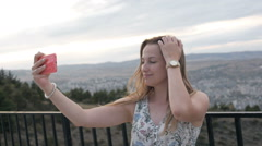 Hipster young girl looking on observation deck and take selfie. View back of Stock Footage
