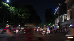 Timelapse of night city, seen busy road with passing cars, motorcycles and Arkistovideo