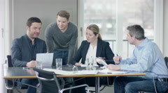Group of businesspeople discussing important documents at businessmeeting Stock Footage