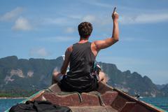 Man enjoys the journey on a boat Stock Photos