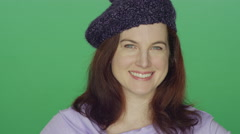 Redhead woman wearing a beret smiling, on a green screen background Stock Footage
