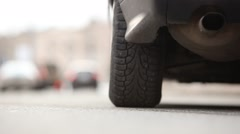 Rear tyre of starting car, vehicle begin to move, environment road noise. Stock Footage