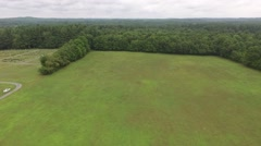 Aerial shot of Sands Point Preserve in NY, flying over grass field Stock Footage