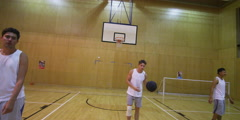 Competitive basketball players, playing on indoor court. Arkistovideo