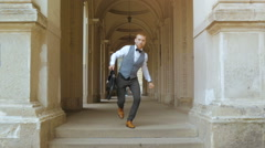 Business man jump and run with old city background Stock Footage