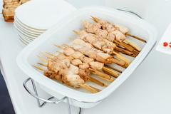 Salmon kebabs only fish on wooden skewers Stock Photos