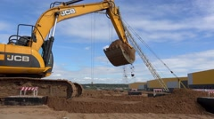 Work Excavator at a construction site. Stock Footage