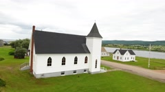 Aerial shot of a beautiful church in Margaree Harbour Cape Breton Stock Footage